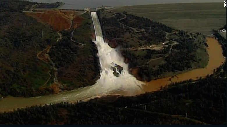 200,000 flee as dam threatens wall of water
