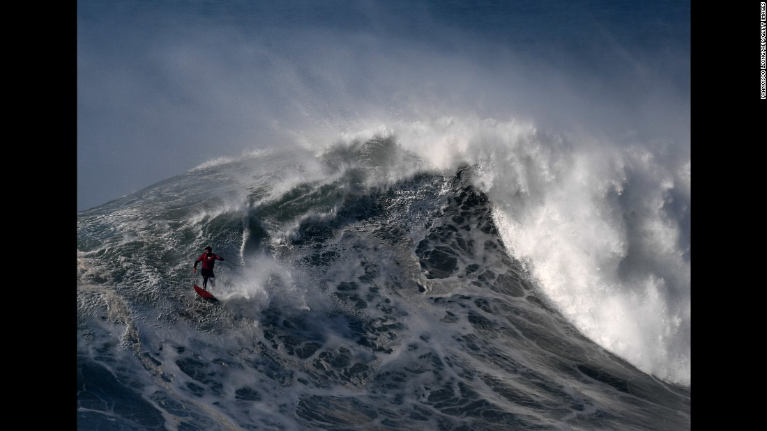 Rafael Tapia surfs a big wave in Praia do Norte, Portugal, on Friday, February 10.