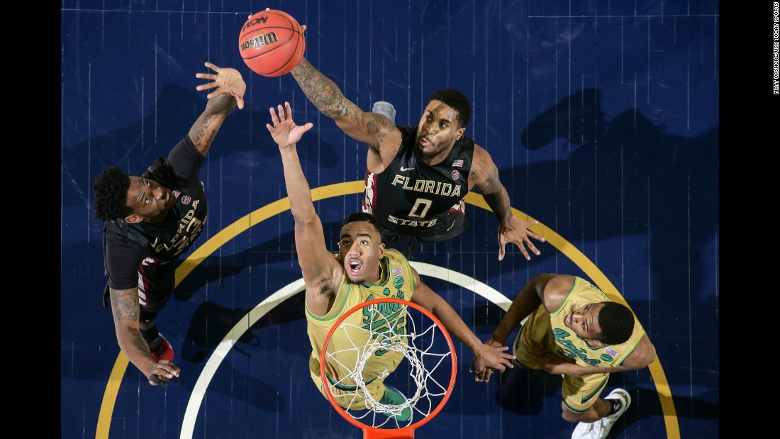 Notre Dame's Bonzie Colson, second from left, competes for a rebound with Florida State's Jarquez Smith, left, and Phil Cofer during a college basketball game in South Bend, Indiana, on Saturday, February 11. Colson had a career-high 33 points and 13 rebounds as Notre Dame won 84-72.