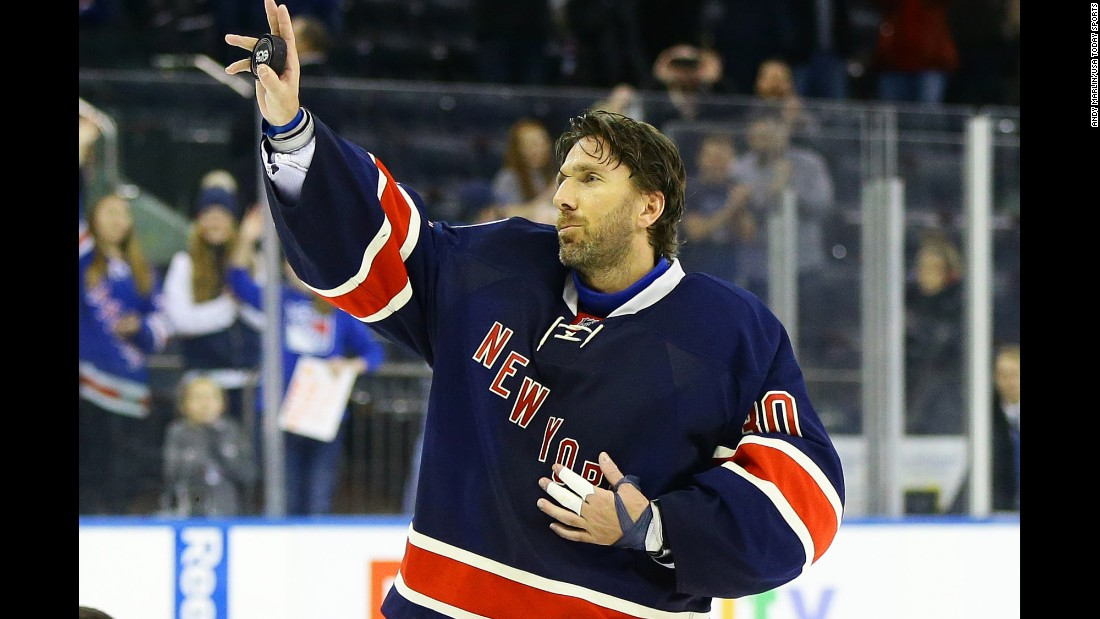 New York Rangers goalie Henrik Lundqvist waves to the crowd Saturday, February 11, after becoming the 12th goalie in NHL history to win 400 games.