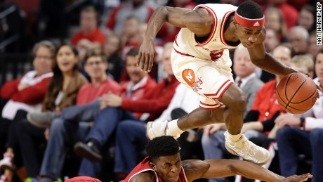Nebraska's Glynn Watson Jr. (5) leaps over Wisconsin's Khalil Iverson (21) as they scramble the ball during the first half of an NCAA college basketball game in Lincoln, Neb., Thursday, Feb. 9, 2017. (AP Photo/Nati Harnik)