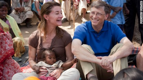 Bill and Melinda Gates visit with residents of the village of Jamsaut in India in 2011.