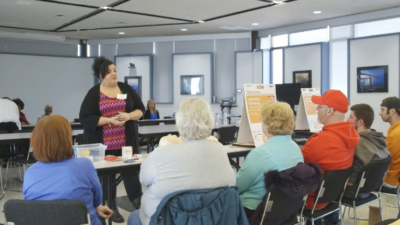Sonia Rudolph shows a group how to give naloxone, the antidote for an opioid overdose, to someone who is overdosing.