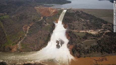 OROVILLE, CA - FEBRUARY 13: Oroville lake, the emergency spillway, and the damaged main spillway, are seen from the air on February 13, 2017 in Oroville, California. Almost 200,000 people were ordered to evacuate the northern California town after a hole in an emergency spillway in the Oroville Dam threatened to flood the surrounding area. (Photo by Elijah Nouvelage/Getty Images)