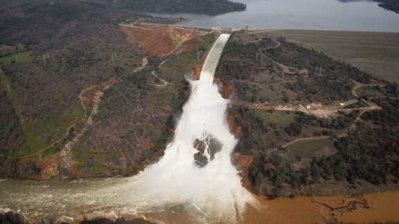 Oroville lake, the emergency spillway, and the damaged main spillway, are seen from the air on February 13, 2017 in Oroville, California.