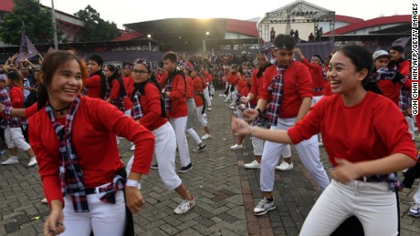 Dancers perform for supporters of the Jakarta governor at his final campaign rally Saturday.