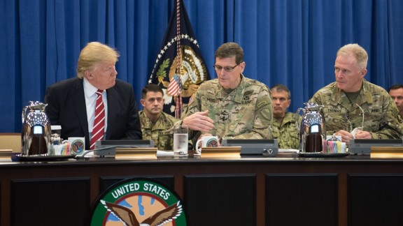 """President Donald Trump talks with Gen. Joseph Votel, commander of US Central Command Commander, and Gen. Raymond """"Tony"""" Thomas, US Special Operations Command Commander at MacDill, Air Force Base, FL, Feb. 6, 2017 (Photo Department of Defense)"""