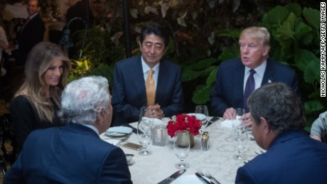 President Donald Trump, Japanese Prime Minister Shinzo Abe, first lady Melania Trump, and Robert Kraft, owner of the New England Patriots, dine at Trump's Mar-a-Lago resort on February 10, 2017 in West Palm Beach, Florida.
