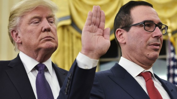 Trump watches as Steven Mnuchin is sworn in as treasury secretary on Monday, February 13. The Senate vote was 53-47, mostly along party lines.