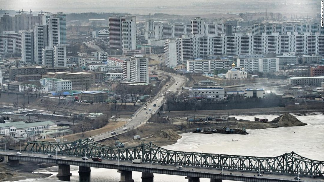 The view over the frozen Taedong River shows residential areas of Pyongyang on February 15.
