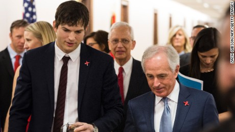 Ashton Kutcher walks with Senate Foreign Relations Committee Chairman Sen. Bob Corker (R-TN) before testifying on Capitol Hill on February 15, 2017 in Washington, DC.