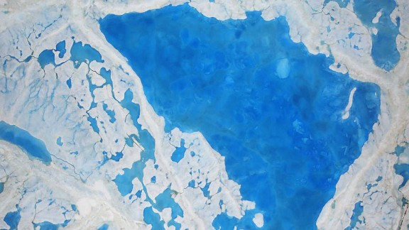 Pools of melt are becoming more common on the ice in the Arctic Sea.