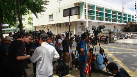 Journalists gather outside a hospital forensic department Wednesday in Kuala Lumpur, Malaysia.