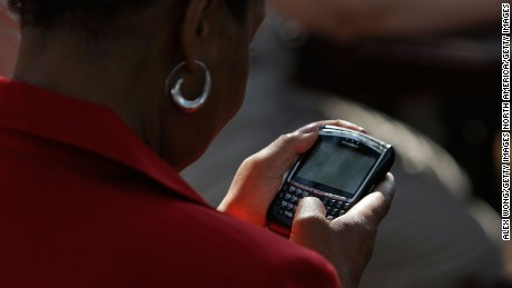 CHESTER, VA - AUGUST 21:   A woman works on her Blackberry phone after she got instructions on how to receive text message about who will be the running mate of Presumptive Democratic Presidential candidate U.S. Sen. Barack Obama (D-IL) during a campaign stop at John Tyler Community College August 21, 2008 in Chester, Virginia. The media have been reported that Obama will announce who is his running mate in Springfield, Illinois on Saturday.  (Photo by Alex Wong/Getty Images)