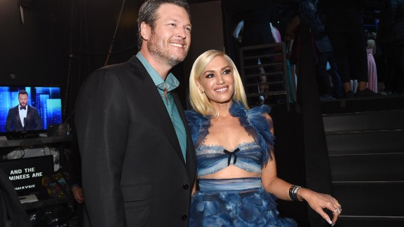 "Blake Shelton poses with girlfriend and fellow ""The Voice"" coach, Gwen Stefani."