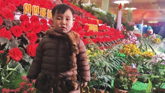A boy visits the Kimjongilia flower show on February 16. The red flowers are named after the late North Korean leader Kim Jong Il.