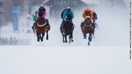 ST MORITZ, SWITZERLAND - FEBRUARY 08: Andre Best (C) riding Cap Sizun leads the field during the GP Guardaval Immobilien - Zuoz / Passugger Flat Race of the White Turf St  Moritz on February 8, 2015 in St Moritz, Switzerland.  (Photo by Matthias Hangst/Bongarts/Getty Images)