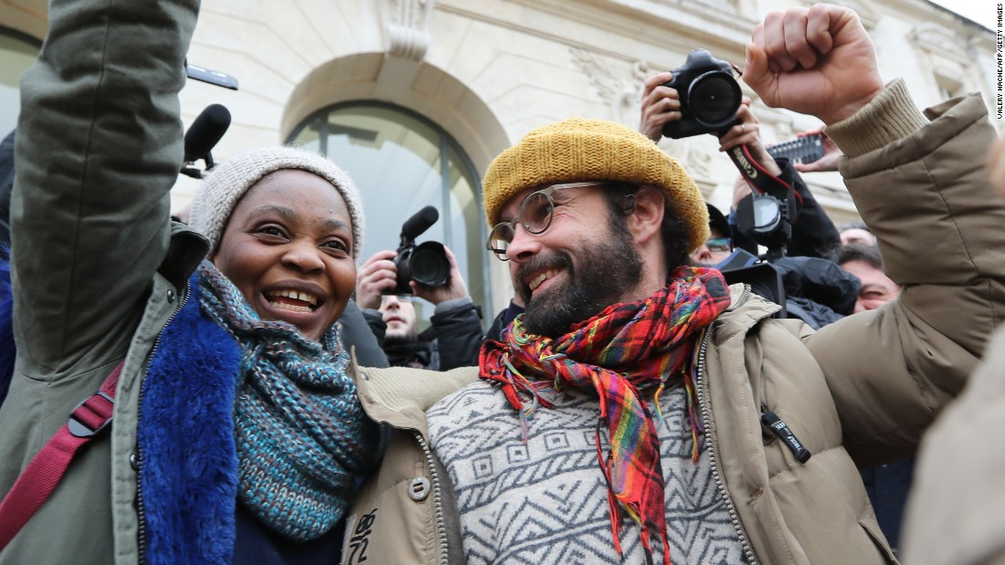 "French farmer Cedric Herrou gestures next to a Malian woman named Khadidja as he leaves a courthouse in Nice, France, on Friday, February 10. A French court <a href=""http://www.cnn.com/2017/02/10/europe/french-farmer-migrant-trial/"" target=""_blank"">gave Herrou a suspended fine of 3,000 euros ($3,200)</a> for helping migrants enter France illegally, the prosecutor told CNN. Herrou has taken in dozens of migrants over the past year."