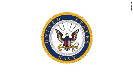 Navy commander charged in long-running scandal