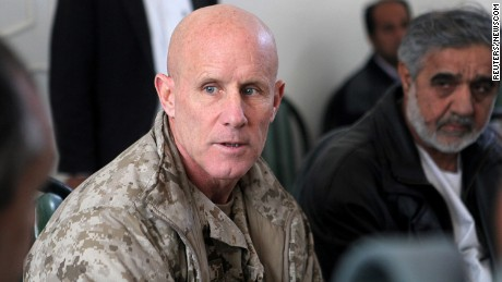 Vice Adm. Robert S. Harward, commanding officer of Combined Joint Interagency Task Force 435, speaks to an Afghan official during his visit to Zaranj, Afghanistan, in this January 6, 2011 handout photo.