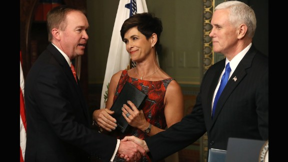 Pence shakes hands with Mick Mulvaney after swearing him in as the new director of the Office of Management and Budget on Thursday, February 16. Mulvaney