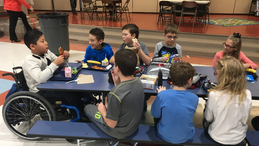 Jason has lunch with his classmates on December 9, 2016 at Sni-A-Bar Elementary, where he's a fourth grader.