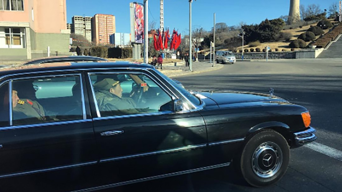 North Korean soldiers ride on February 17, in a black Mercedes-Benz on the streets of Pyongyang.