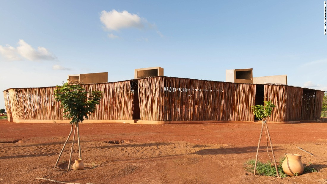 "Wrapping around the Lycée Schorge to offer natural shading is a system of screens cut from  fast-growing wood. ""It can be 40 degrees in the summer [in Burkina Faso] which lasts eight months,"" says Kéré.<br /><br />Desert conditions within rural Burkina Faso is taken into account within the architect's daring design with young trees planted as ""a barrier against the Sahara winds."""