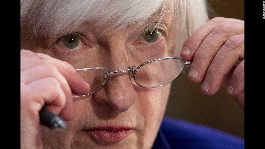 "Federal Reserve chair Janet Yellen adjusts her glasses while testifying before the Senate Banking Committee on Tuesday, February 14. Yellen signaled that <a href=""http://money.cnn.com/2017/02/14/news/economy/janet-yellen-federal-reserve-hike-testimony/"" target=""_blank"">the next interest-rate increase</a> could come as early as March."