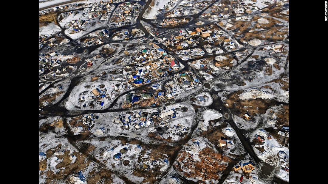 "This aerial photo, taken Monday, February 13, shows the Oceti Sakowin camp where people have gathered <a href=""http://www.cnn.com/2016/09/09/us/gallery/north-dakota-oil-pipeline/index.html"" target=""_blank"">to protest the Dakota Access Pipeline</a> in Cannon Ball, North Dakota. The pipeline is a $3.7 billion project that would cross four states and change the landscape of the US crude oil supply. The Standing Rock Sioux tribe says the pipeline would affect its drinking-water supply and destroy its sacred sites."