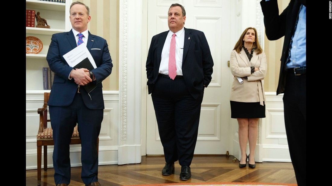 From left, White House press secretary Sean Spicer, New Jersey Gov. Chris Christie and Christie's wife, Mary Pat, watch President Trump sign a piece of legislation in the White House Oval Office on Tuesday, February 14.