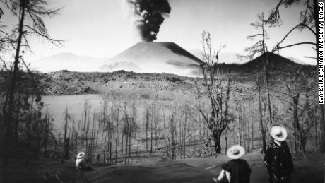 circa 1950:  Ash pouring from Mount Par cutin, 'El Monstre', into the atmosphere. The volcano erupted from 1943 until 1952. The church in the village of San Juan was the only structure to be spared in the village, and still stands half buried in solidified lava.  (Photo by Evans/Three Lions/Getty Images)
