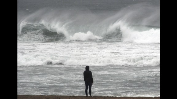 Large waves pound the shore at El Porto in Manhattan Beach as storms slam the Los Angeles area on February 17.