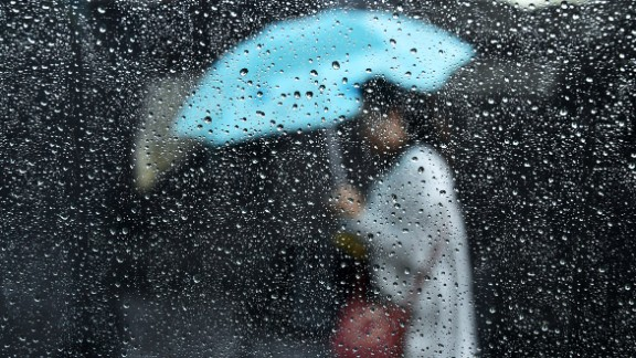 The downpour doesn't deter a pedestrian in Los Angeles on February 17.