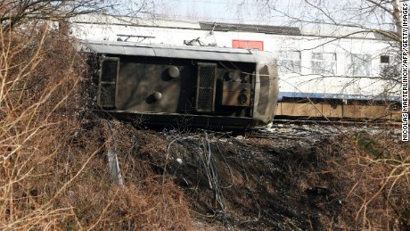 The train derailed shortly after leaving Leuven station Saturday, causing one car to overturn.