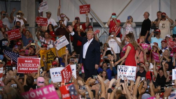 MELBOURNE, FL - FEBRUARY 18:  President Donald Trump and Melania Trump stand together during a campaign rally at the AeroMod International hangar at Orlando Melbourne International Airport on February 18, 2017 in Melbourne, Florida. President Trump is holding his rally as he continues to try to push his agenda through in Washington, DC.  (Photo by Joe Raedle/Getty Images)