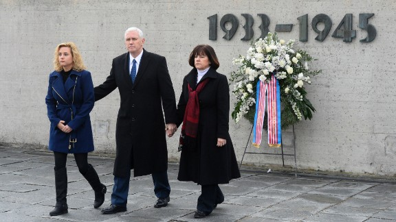 US Vice President Mike Pence, his wife Karen, and daughter Charlotte, walk from the International Memorial of former Nazi concentration camp of Dachau after laying a wreath on February 19.