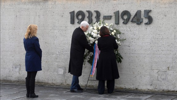 Pence is joined by his wife, Karen, and his daughter Charlotte as he lays a wreath at the Dachau Concentration Camp Memorial Site in southwestern Germany in February 2017.