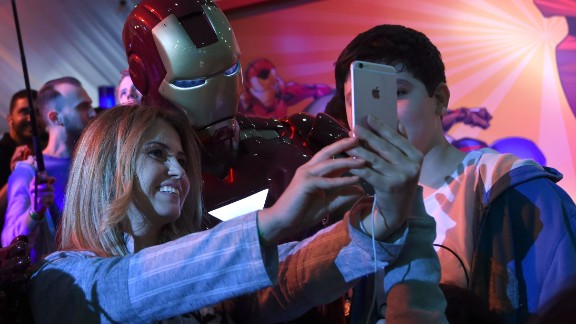 """A Lebanese woman poses for a selfie with a man dressed up as """"Iron Man"""" during Saudi Arabia"""