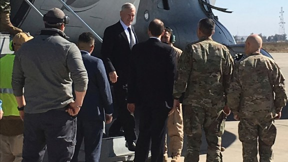 U.S. Secretary of Defense Jim Mattis, center, arrives at Baghdad International Airport, Iraq, on an unannounced trip Monday, Feb. 20, 2017. Mattis said Monday the United States does not intend to seize Iraqi oil, shifting away from an idea proposed by President Donald Trump that has rattled Iraq's leaders. (AP Photo/Sagar Meghani)
