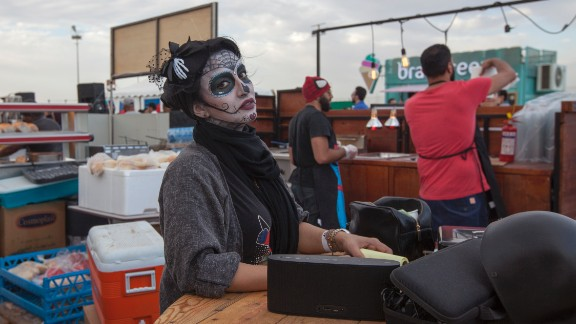 A woman has her face made up at the event.
