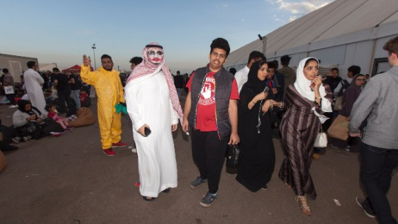 Attendees dress up and genders mix at Saudi Arabia