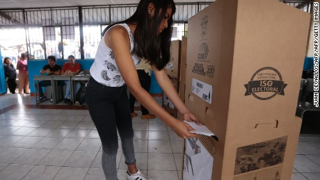 A woman deposits her vote in a ballot box at a polling station in Guayaquil during Ecuador's general elections on February 19, 2017. Ecuador's elections will decide who succeeds leftist President Rafael Correa after a decade in power. / AFP / Juan Cevallos        (Photo credit should read JUAN CEVALLOS/AFP/Getty Images)