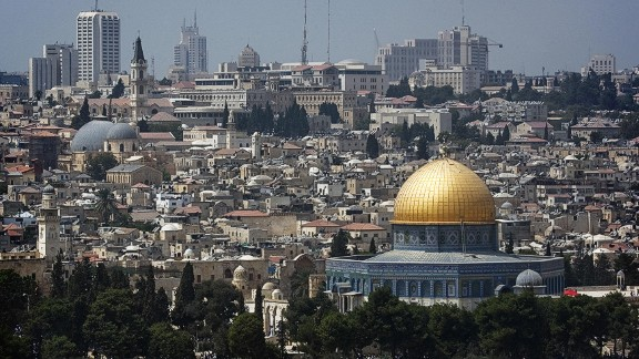 A picture shows the skyline of Jerusalem with the Dome of the Rock mosque, at the Al-Aqsa mosque compound in the city?s old city, where thousands of Muslim pilgrims crowded for the first Friday noon prayer of Ramadan on September 5, 2008. Israel beefed up its police deployments in Jerusalem as tens of thousands of Muslim faithful were expected to attend the first Friday prayers of Ramadan at the Al-Aqsa mosque compound in the Old City. AFP PHOTO/MARCO LONGARI (Photo credit should read MARCO LONGARI/AFP/Getty Images)