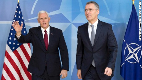 US Vice President Mike Pence walks next to NATO Secretary General Jens Stoltenberg during a meeting at NATO headquarters in Brussels on February 20, 2017.