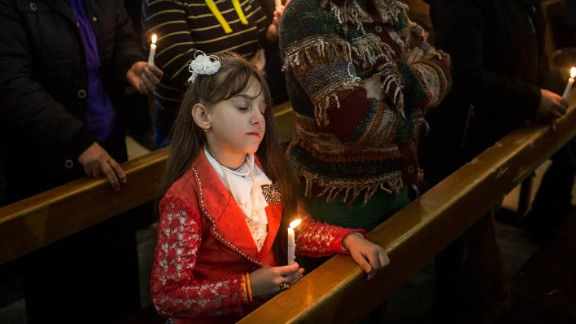 A young girl takes part in a Christmas Day Mass at a church in the predominantly Christian town of Qaraqosh. The area