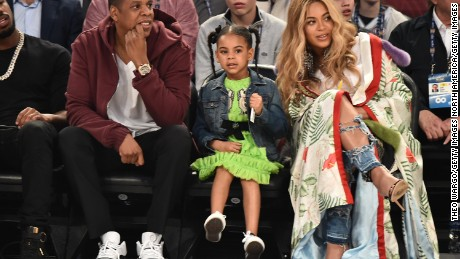 Jay Z, Blue Ivy Carter and Beyoncé attend the NBA All-Star Game 2017 in New Orleans, Louisiana.  (Photo by Theo Wargo/Getty Images)