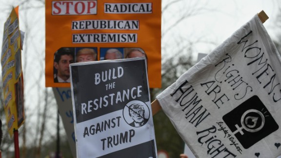 Protesters hold banners during a demonstration against Mike Pence's visit to Brussels on Monday.