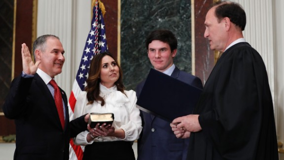 Supreme Court justice Samuel Alito swears in Scott Pruitt as the new administrator of the Environmental Protection Agency on Friday, February 17. Holding the Bible is Pruitt