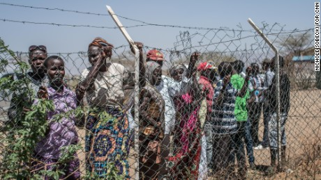 Crowds gather outside the airstrip at Kakuma camp in northwest Kenya, where about 160,000 refugees live.